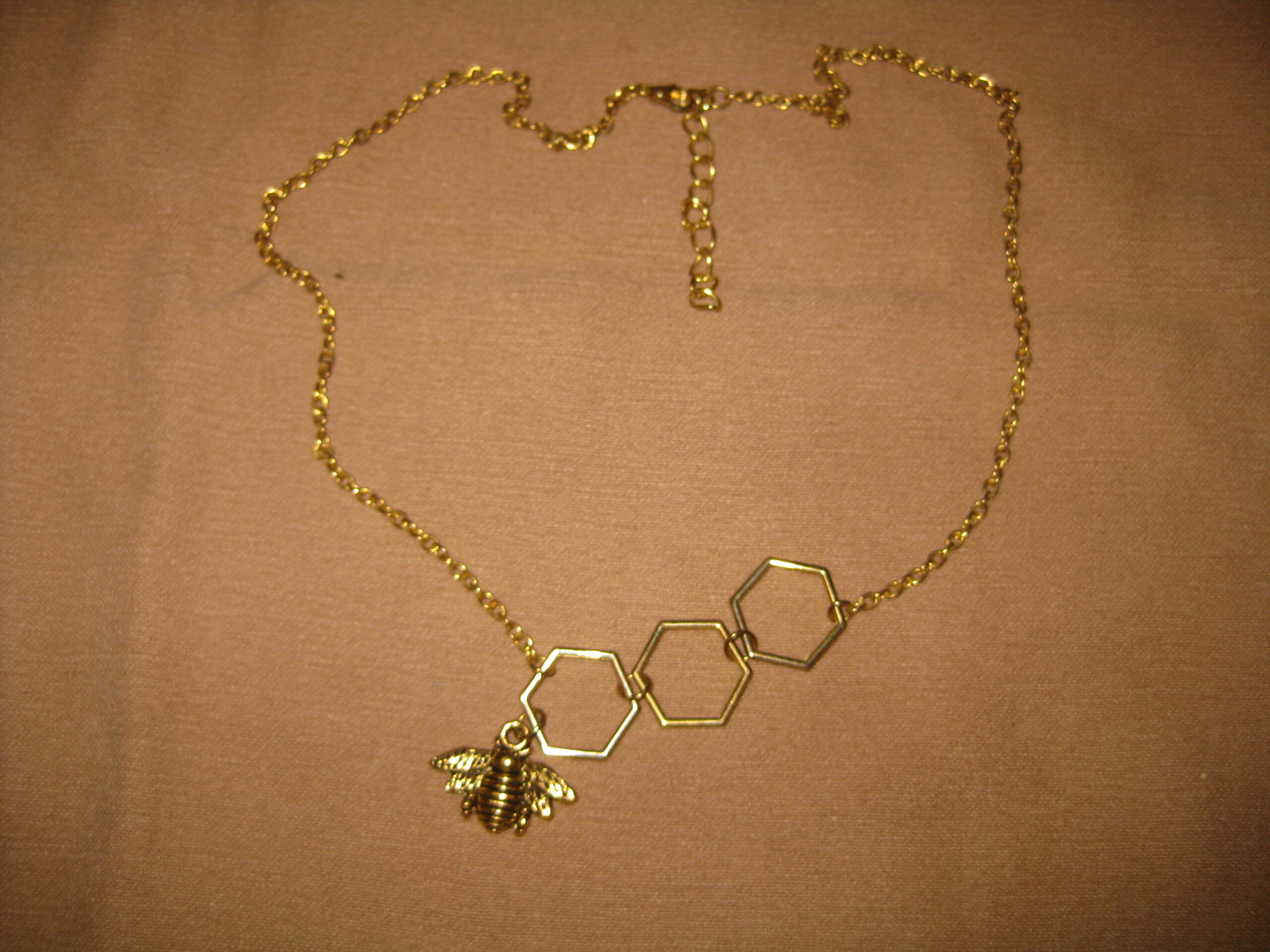 Necklace with a bee theme